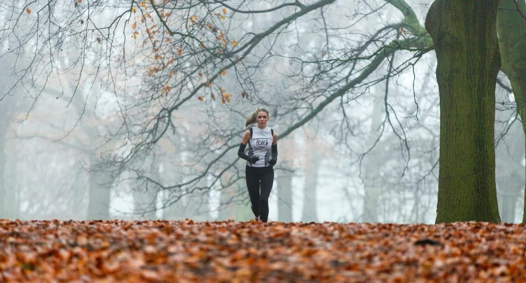 Runner in autumn scenery. Studies [1] have shown that moderate exercise causes positive changes on the central nervous system: Stress hormone (e.g. Adrenalin) levels are modulated. Even more than that, exercise makes us happy: Serotonin is released which is a mood booster!